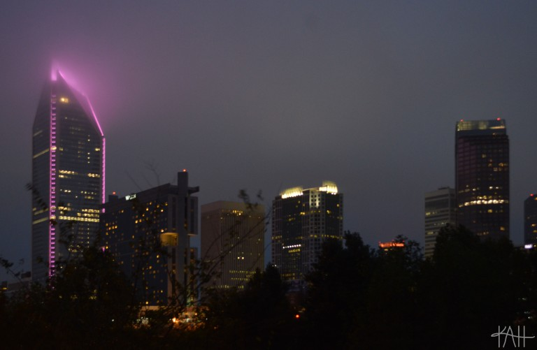 partial Charlotte skyline with the Duke Energy Center lit up for Breast Cancer Awareness Month. (Oct. 3rd)