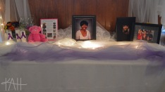 A table was decorated in memory of Jennifer Merriman, who was a victim of domestic violence.