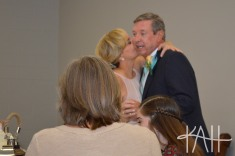 Stealing a kiss during the reception. Many well wishes to this joyous couple!